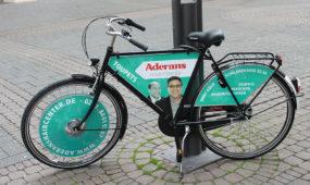 Aderans Hair Center Köln - Fahrrad mit Werbung in der Stadt